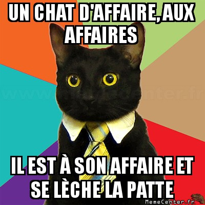 business-cat-un-chat-daffaire-aux-affaires-il-est-a-son-affaire-et-se-leche-la-patte