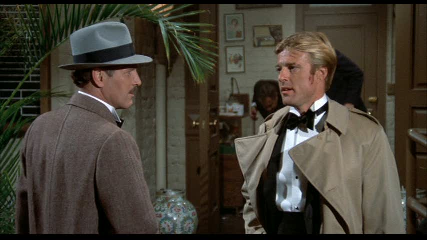 Henry Gondorff (Paul Newman) et Johnny Hooker (Robert Redford) dans THE STING